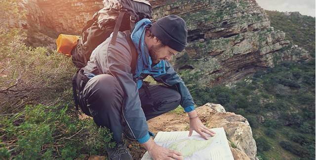 bigstock-Lost-hiker-with-backpack-check-58934933